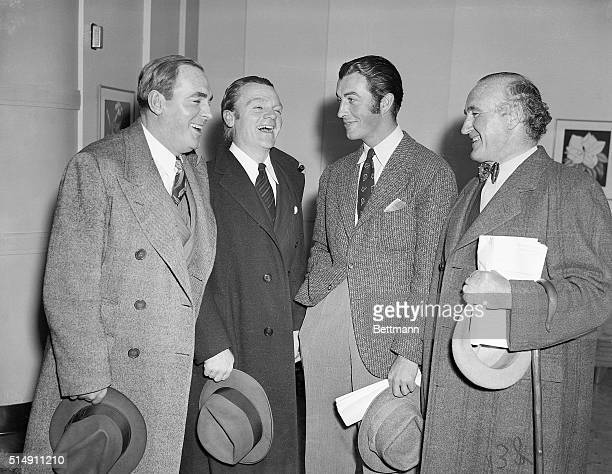 Hollywood, CA- Pat O'Brien, James Cagney, Robert Taylor, and Donald Crisp share a laugh together while attending the broadcast rehearsal for the...
