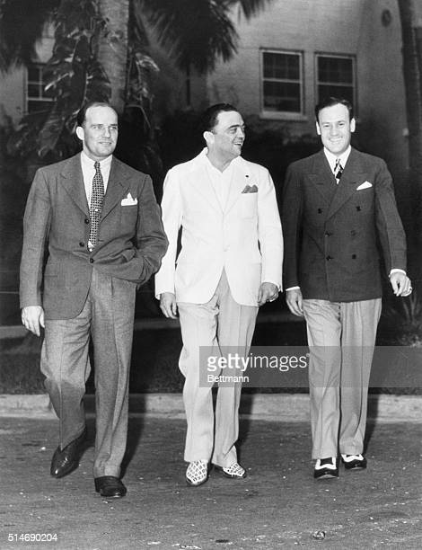 Miami Beach FL L to r Guy Hottell special agent of FBI J Edgar Hoover Chief of the FBI and Clyde Tolson Assistant to Hoover in pursuit in sunshine