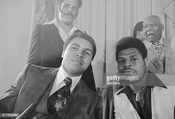 New York, NY- A seemingly serious Muhammad Ali , the world heavyweight boxing champion, tries to match the stern look of challenger, Olympic gold...
