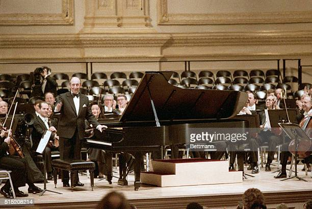 New York NY Pianist Vladimir Horowitz acknowledges applause after his surprise appearance at the reopening of Carnegie Hall