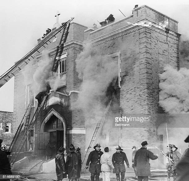 12/1/58Chicago Illinois As firemen battle to quell the blaze smoke pours from the Our Lady of the Angels Roman Catholic parochial school here Dec 1st...