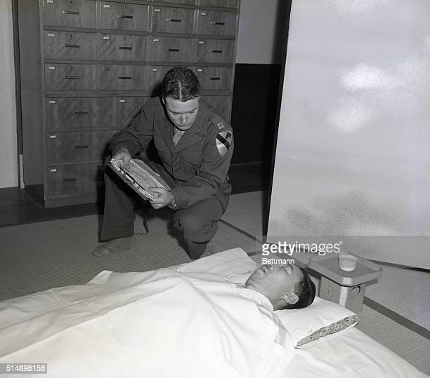 Tokyo Japan The body of Prince Fuminaro Konoye one of Hirohito's closest war time advisers is being examined by Captain Charles F Sewell of Abelene...
