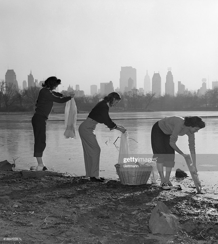 Dry Day, on which New Yorkers were supposed to go shaveless, bathless and laundryless, will probably go down in history as 'Dirty Day' -- but not for these three cuties, Copacabana gals, who observed the water-saving ukase and at the same time stayed next to godliness. They are shown rub-a-dub-dubbing their undies, using the Central Park lake for a washtub, with soap and elbow grease combining with the ancient washboard to complete the job.