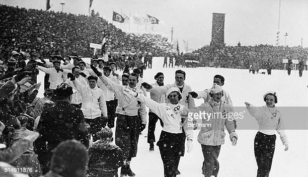 Garmisch Partenkirschen, Germany- Members of the Canadian Winter Olympics team return a Nazi salute, as they pass the reviewing stand in the parade...