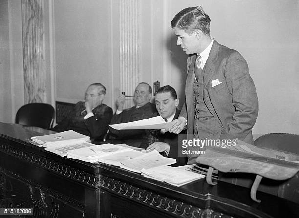 Washington DC Alger Hiss youthful investigator for the Senate Munitions Commitee is shown as he quizzed heads of the Winchester Arms Co of New Haven...