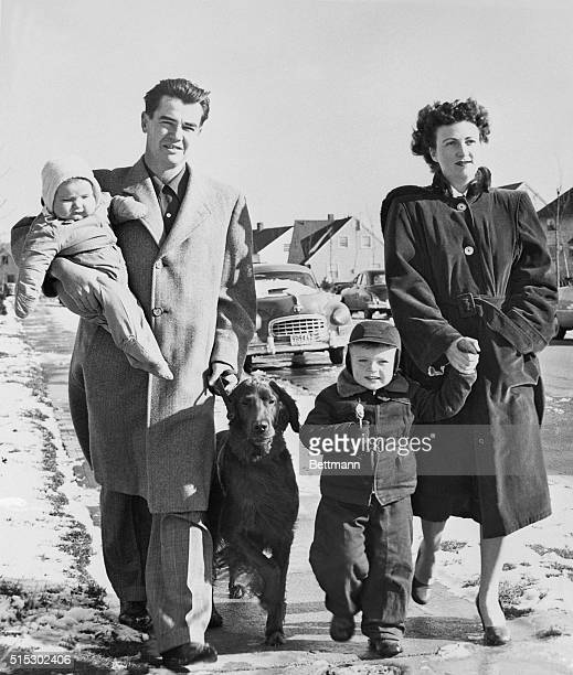 Levittown NY Robert Rehm who fits the census bureau's description of the 'average American' takes a walk with his family through his suburban...