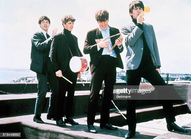 London, England: The Beatles clown on a London rooftop, left to right: Paul McCartney, Ringo Starr, John Lennon, and George Harrison.