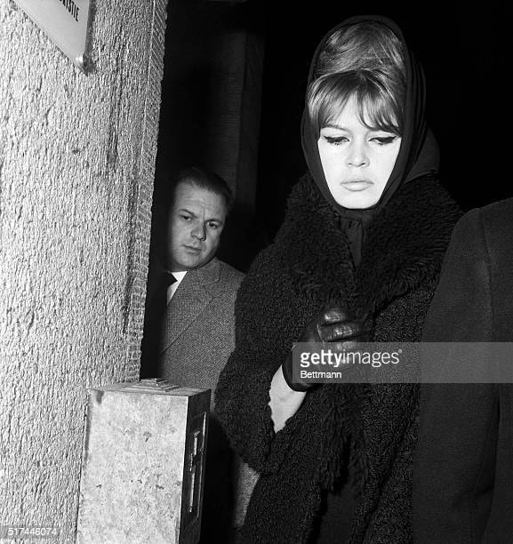 Paris France Among the mourners French actress Brigitte Bardot wears a black scarf around her head as she attends funeral services for actress Vera...
