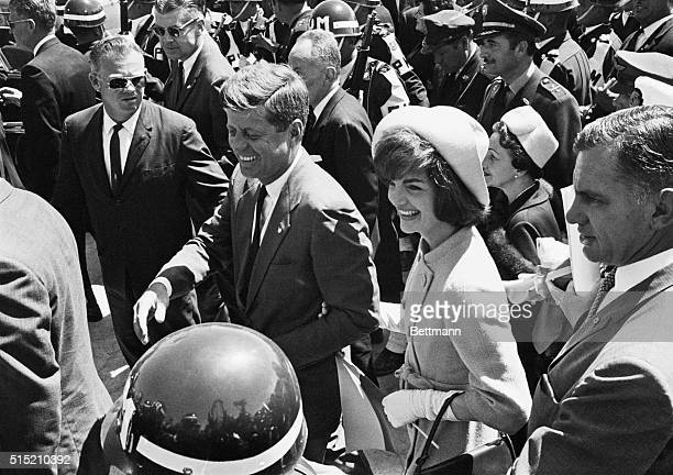 Bogota, Colombia: An enthusiastic reception brings smiles to the faces of President and Mrs. Kennedy as they attended the dedication of a new...