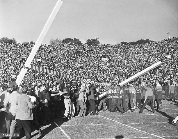Even before the Trojans could kick for the point after their last Rose Bowl touchdown enthusiastic spectators rushed onto the field and almost tore...