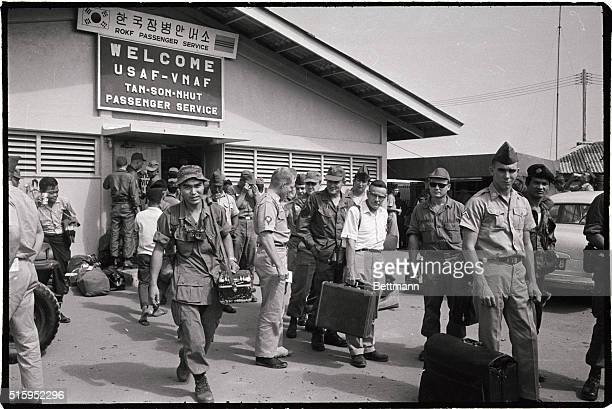 12/19/66Saigon Vietnam Japanese war photographer Kyoichi Sawada of UPI wears a big grin after viewing congratulatory sign posted outside the UPI...
