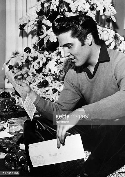 Memphis TN Rock 'n' roll crooner Elvis Presley reads an unexpected 'greeting' a notice to report to military induction on January 20th The idol of...
