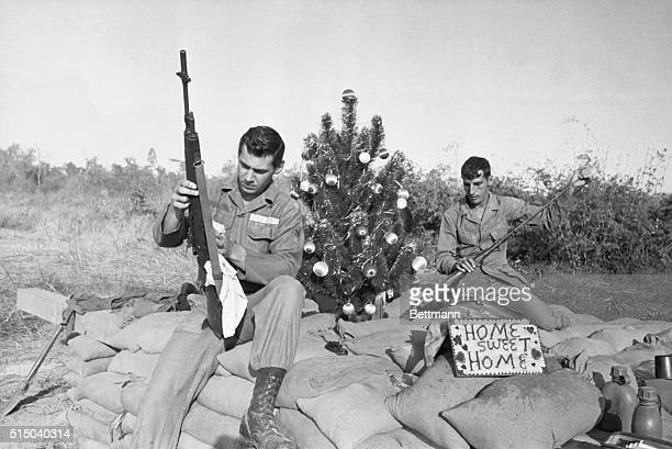 Ka Tum South Vietnam A Christmas tree brightens the 'home sweet home' of a couple of GI's at Ka Tum But instead of Wrapping gifts Charles Pappas of...
