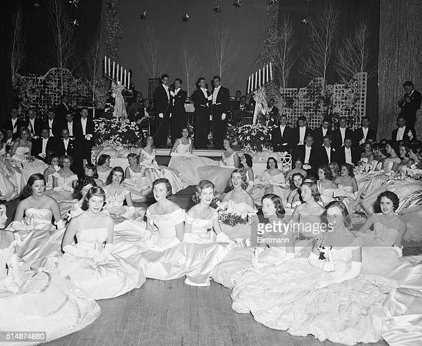 The annual debutante cotillion and Christmas ball was held at the WaldorfAstoria tonight Under the glow of a pink satin canopy and the sparkle of a...