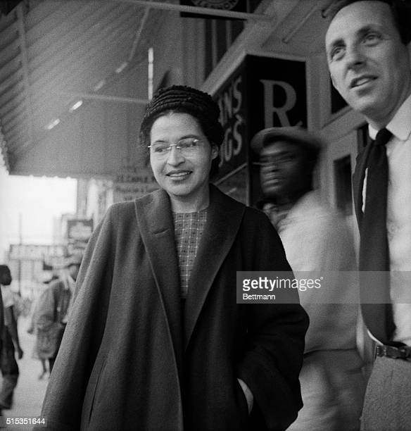 Montgomery AL Mrs Rosa Parks is shown smiling as she walks on the street here December 21 A Supreme Court ruling which banned segregation on the...