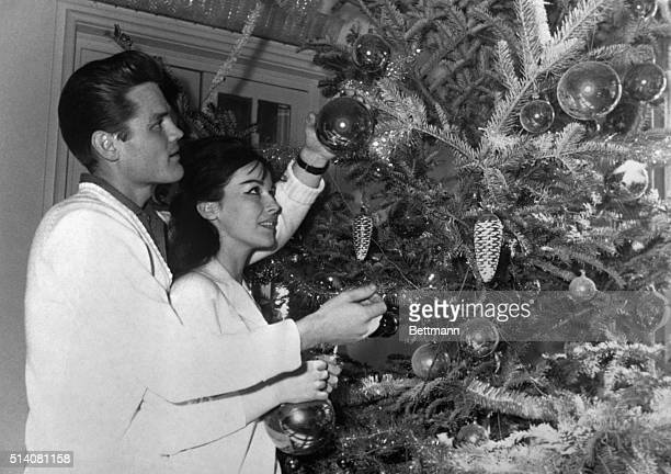 Lucca Italy US Jazzman Chet Baker helps his girlfriend British showgirl Carol Jackson adorn their Christmas tree in Lucca Italy December 20 Baker was...