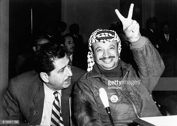 "Rabat, Morocco Yasser Arafat, leader of the Palestine guerrillas, flashes a ""V"" at the opening of the Arab Summit Conference in Rabat, December 21...."