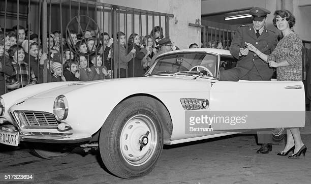 12/21/58Frankfurt Germany Pfc Elvis Presley of rock 'n' roll fame accepts the keys for his newly bought BMW 507 sports car from a pretty...