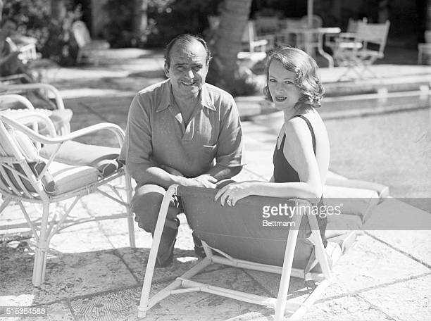 1/22/1937Palm Beach FL Mr and Mrs Douglas Fairbanks are shown sitting by the pool together in Palm beach where they are wintering