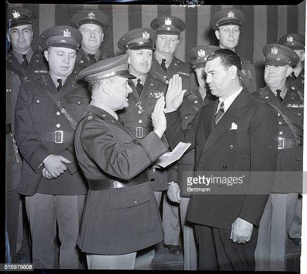 New York, NY- Major General William Ottman , swearing in Jack Dempsey as a First Lieutenant in the New York State Guards, at an impressive ceremony...