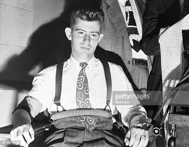 1/22/1947Los Angeles CA Eyes redrimmed from a sleepless night but declaring his conscience clear Robert M Red Manly sits in a chair at police station...