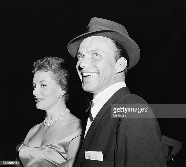 12/2/1955Hollywood CA A dapper radiant Frank Sinatra one of the stars of the film arrives at this Guys and Dolls movie premiere with Deborah Kerr...