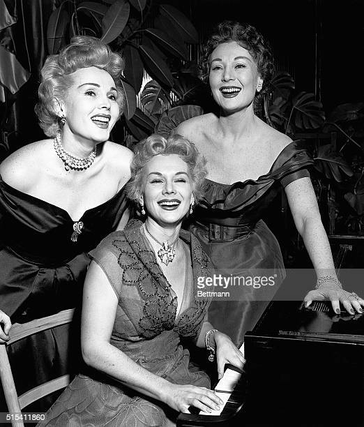 Hollywood CAZsa Zsa Eva and Magda Gabor glamorous trio of sisters doing a night club stint at Ciro's appear at an interview during which they claimed...