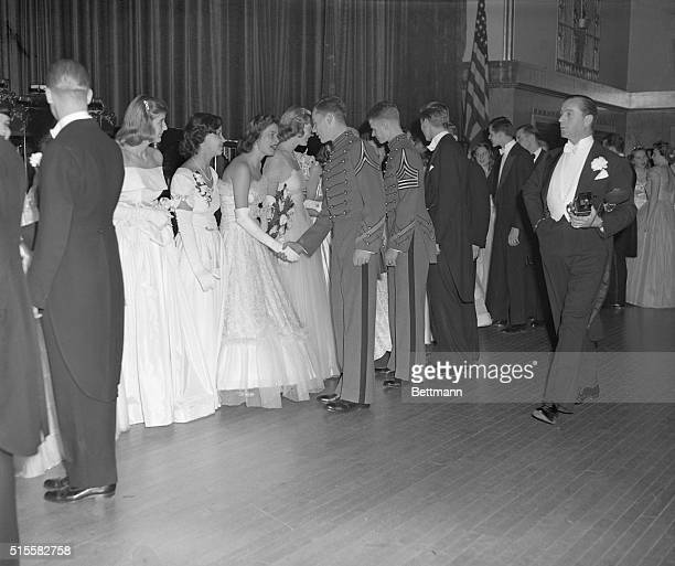 New York,NY: Debutanrte Cotillion and Christmas Ball at the Waldorf-Astoria Hotel. Photo shows cadets and young men of society being greeted by the...
