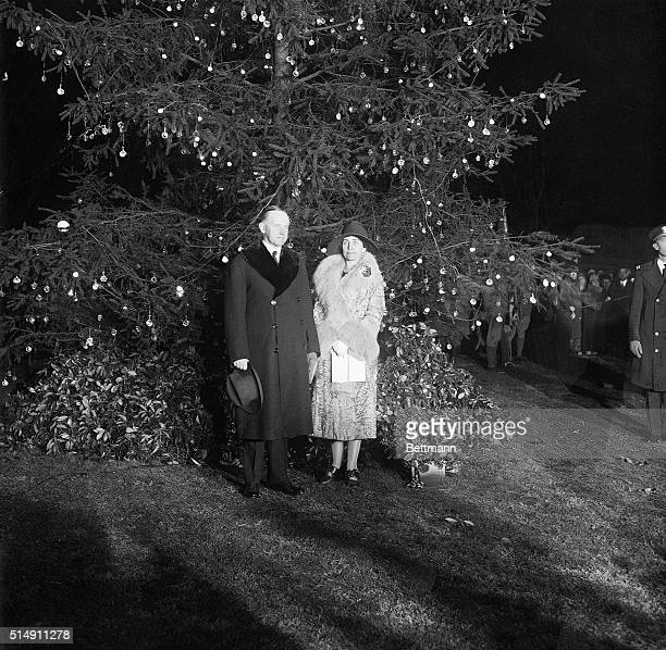 Washington DC Photo shows the President and Mrs Calvin Coolidge standing in front of the national Christmas tree lit by the President officially...