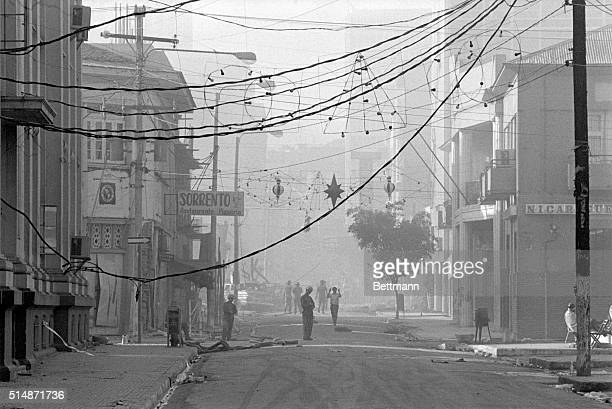 Managua Nicaragua Electric wires dangle amidst Christmas decorations and a cloud of smoke mingles with the smell of death in this devastated Central...