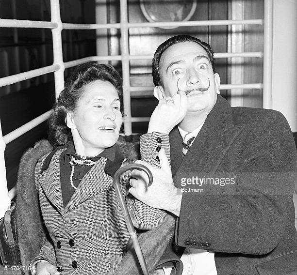 Salvador Dali surrealist painter and his wife Gala arrive in New York Dec 24 aboard the Liner America Dali whose newlyregrown handlebars mustache is...