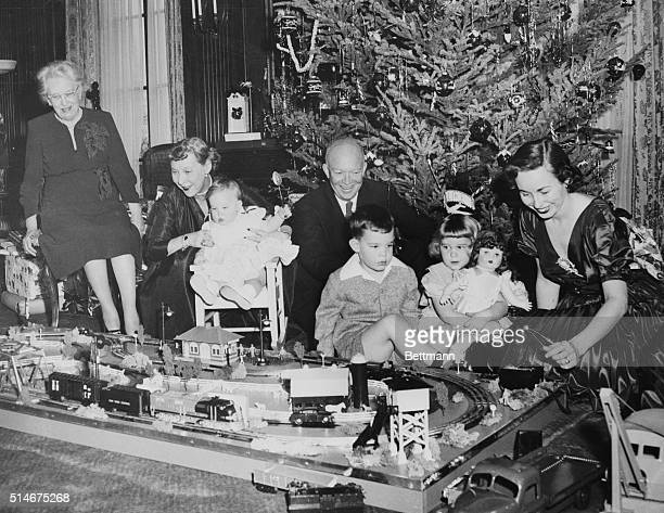 Gathered around the toy train set which made a holiday appearance at 60 Mornigside Drive are the PresidentElect and his family as daughterinlaw Mrs...