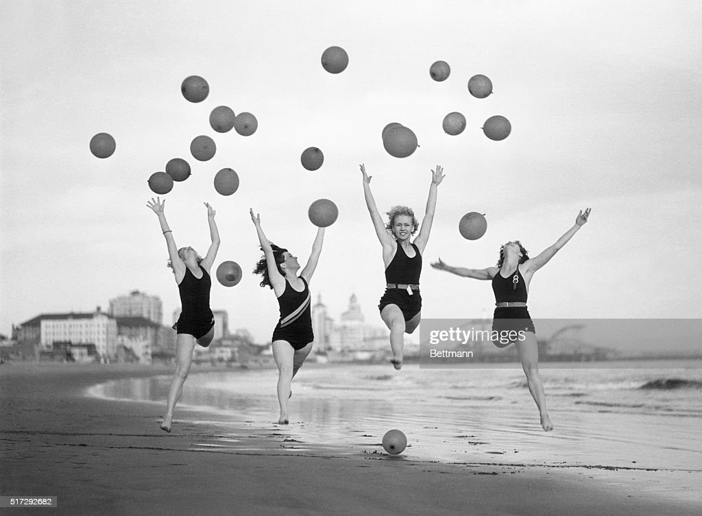 Balloon dancers, trained by Miss Ethel Hunt, find the hard sand an ideal place to practice to the music of the ocean breakers at Long Beach, CA.