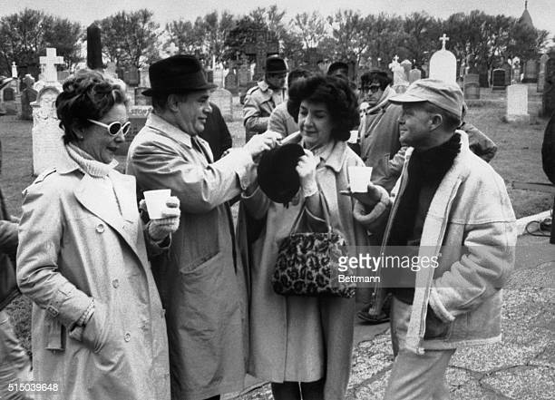 New York NY Author Truman Capote looks on as actors Elenor Perry Martin Balsam and Maureen Stapleton prepare to do another scene in a cemetery here...