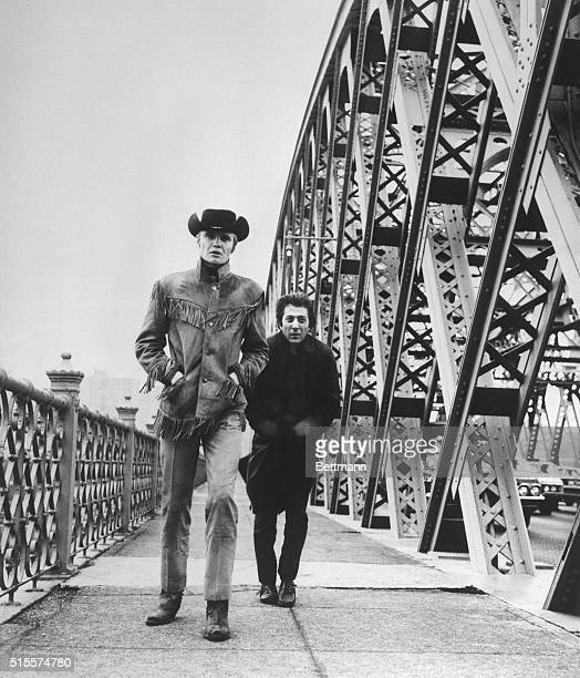 Hoffman and the Midnight Cowboy Jon Voight cross New York's Willis Avenue Bridge in a scene from the film the story of two men who discover friendship