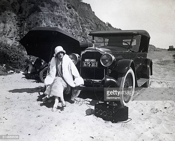 Los Angeles, CA: Above is pictured Estelle Taylor, the young lady whose name has often been linked with that of the heavyweight champion, seated on...