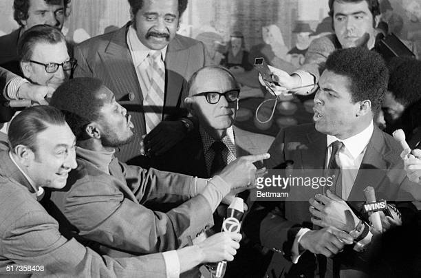 New York, NY- Each claiming to be the true champion, Cassius Clay and Joe Frazier, the recognized heavyweight title holder, engage in a shouting...