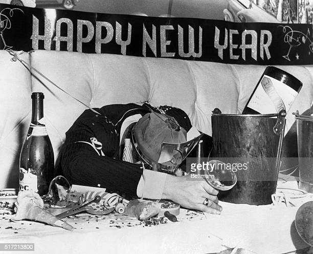 New York, NY-All that's left of 1947 is a headache and a job for the cleaners. This celebrant, who celebrated wildly and well at the Palm Beach Club...