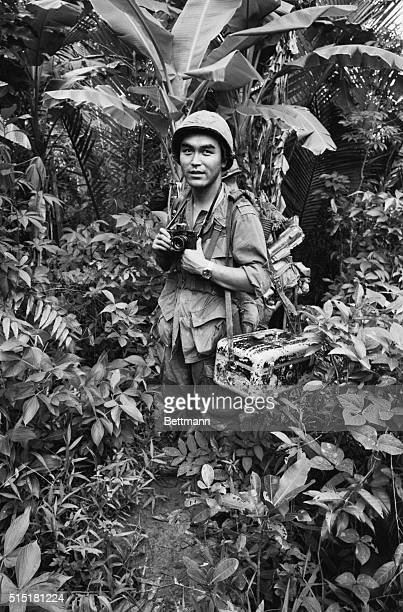 Vietnam Japanese UPI war photographer Kyoichi Sawada in Vietnam shown in the combat area in December of 1967 Depicted holding camera in the jungle