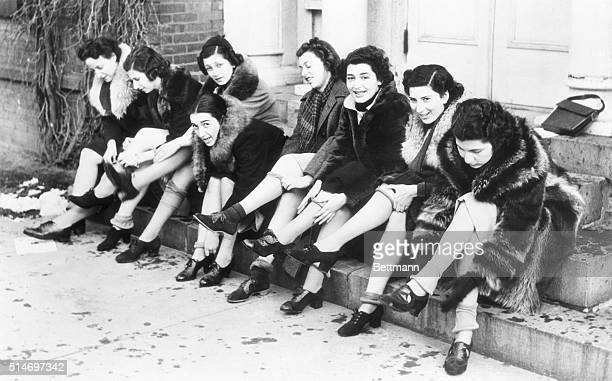 12/31/37Poughkeepsie New York Silk to feed antiJapanese bonfire flames is gathered from the shapely limbs of these Vassar girls as delegates as the...