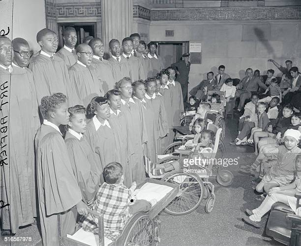 In the children's ward of Bellevue Hospital the choir of BethuneCookman College Daytona Beach Fl sang Christmas carols to cheer NYC's bed ridden...