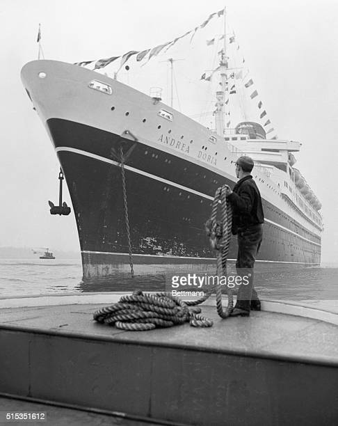 1/23/1953New York NY Deckhand Candido Coelho of Jersey City holds a hawser on the stern of his tugboat Jan 23 as he observes the newest addition to...