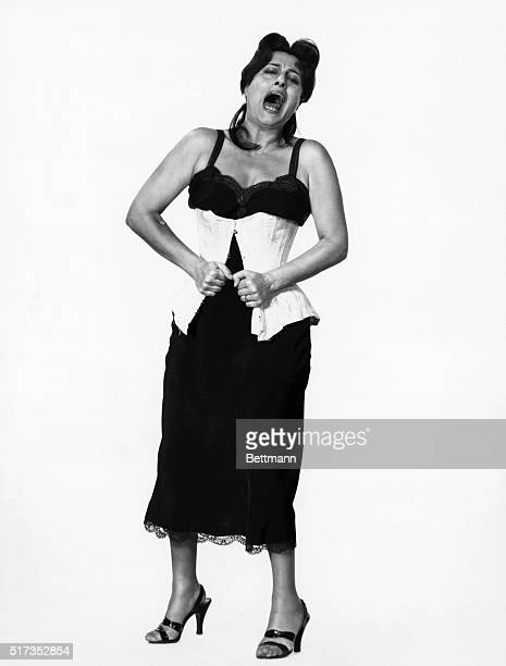 12/3/1955New York New YorkPutting the squeeze on herself is earthy Italian actress Anna Magnani Usually she's not too concerned about her looks but...