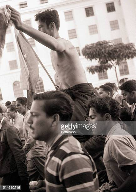 1/23/1958Caracas VenezuelaThe crowd celebrating the downfall of dictator Marcos Perez Jimenez carries a soldier who was reportedly totured by the...