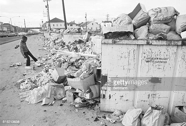 New Orleans, Louisiana- A small boy kicks a can onto the heap of garbage along Orleans St., near the city auditorium 1/23, on the fourth day of a...