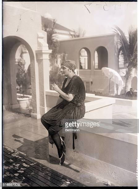 1/24/1923Palm Beach FL Mrs WR Levintritt of New York enjoys a smoke at the Casino Palm Beach Mrs Levintritt is wearing a smart bathing suit of black...