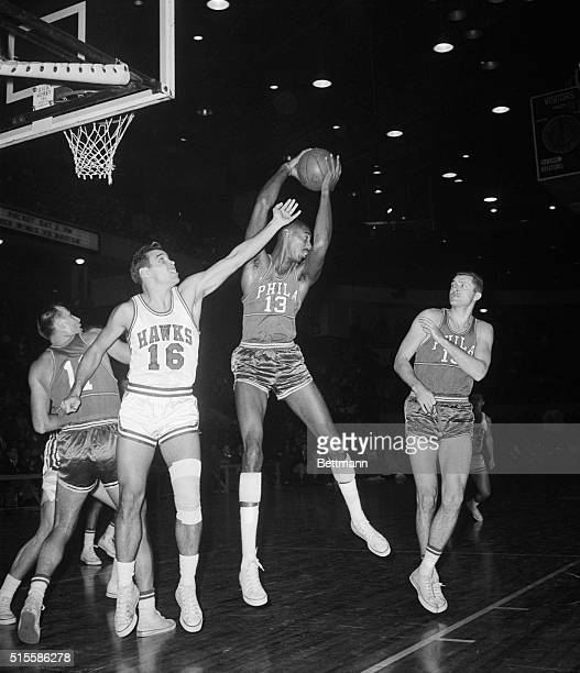 12/4/1959Detroit MI Philadelphia's Wilt Chamberlain grabs a rebound as St Louis Hawks' Cliff Hagan tries to knock the ball out of his hands...