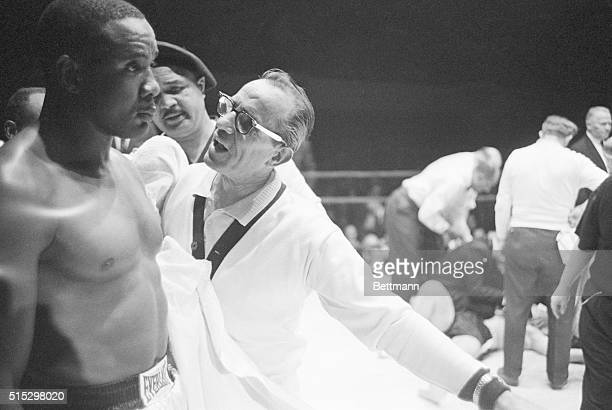 12/4/1961Philadelphia PA Heavyweight Sonny Liston stares blankly as his handler yells to him that the fight is over and we won Dec 4 The fight ended...