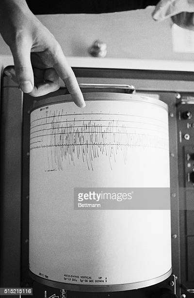 1/24/1980Berkeley CA A finger points to a heavy needle sweep which indicates an earthquake on a seismograph at a University of California...