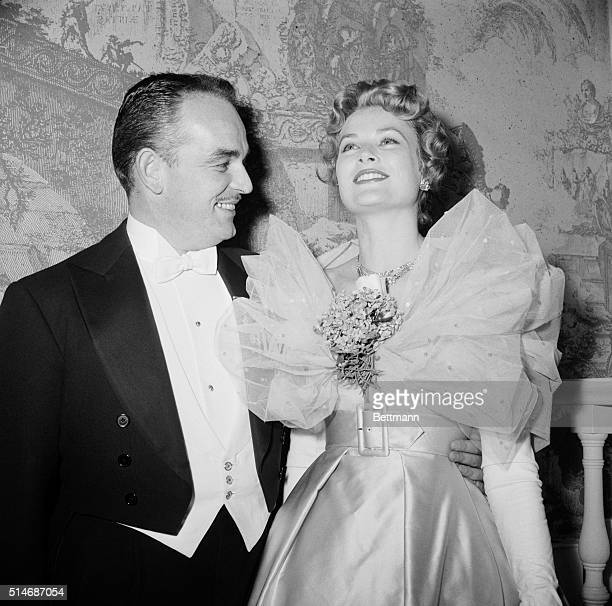 New York: Prince Rainier III and Princess Grace of Monaco add much to the glamor of the Imperial Ball at the Astor Hotel here Dec. 4th. America's...